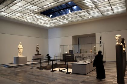 a-woman-looks-at-exhibits-at-the-louvre-abu-dhabi-in-abu-dhabi_5972942